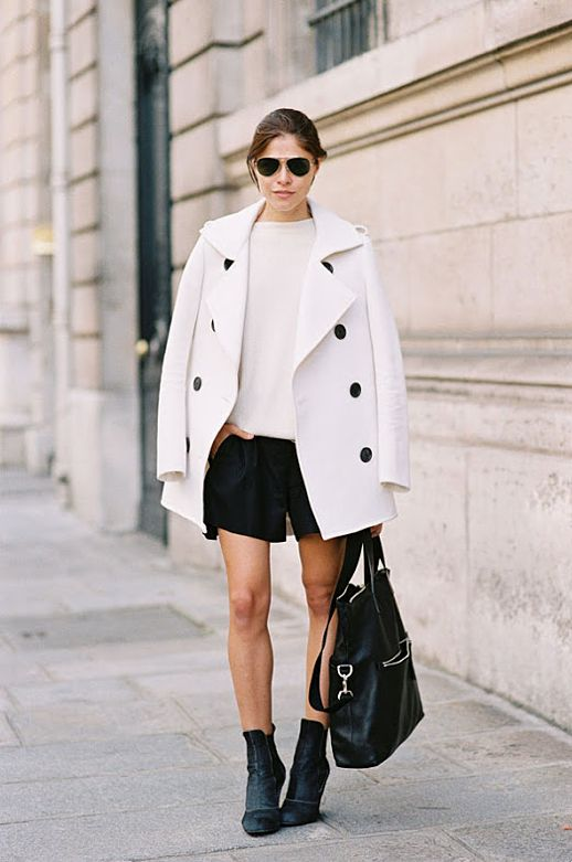 black shorts white coat ankle boots