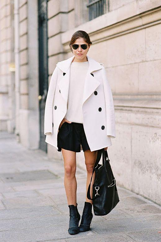 black shorts white coat ankle boots